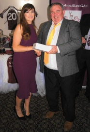 Ladies' manager Enda Hannon receiving an award for all his hard work this year.