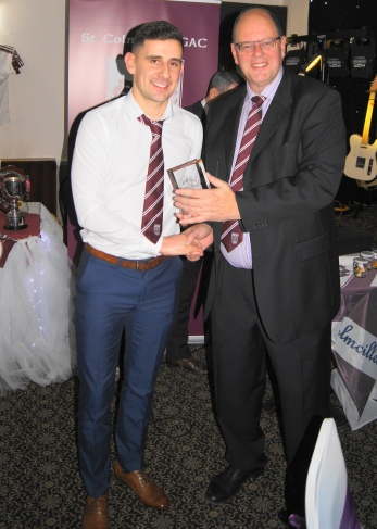 Mark Hayes receives the Players' Player of the Year Award.